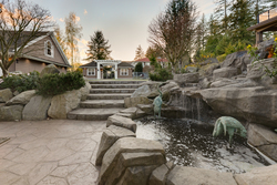 35-custom-fountain-with-incredible-stone-work-leading-to-backyard at 5615 121a Street, Panorama Ridge, Surrey