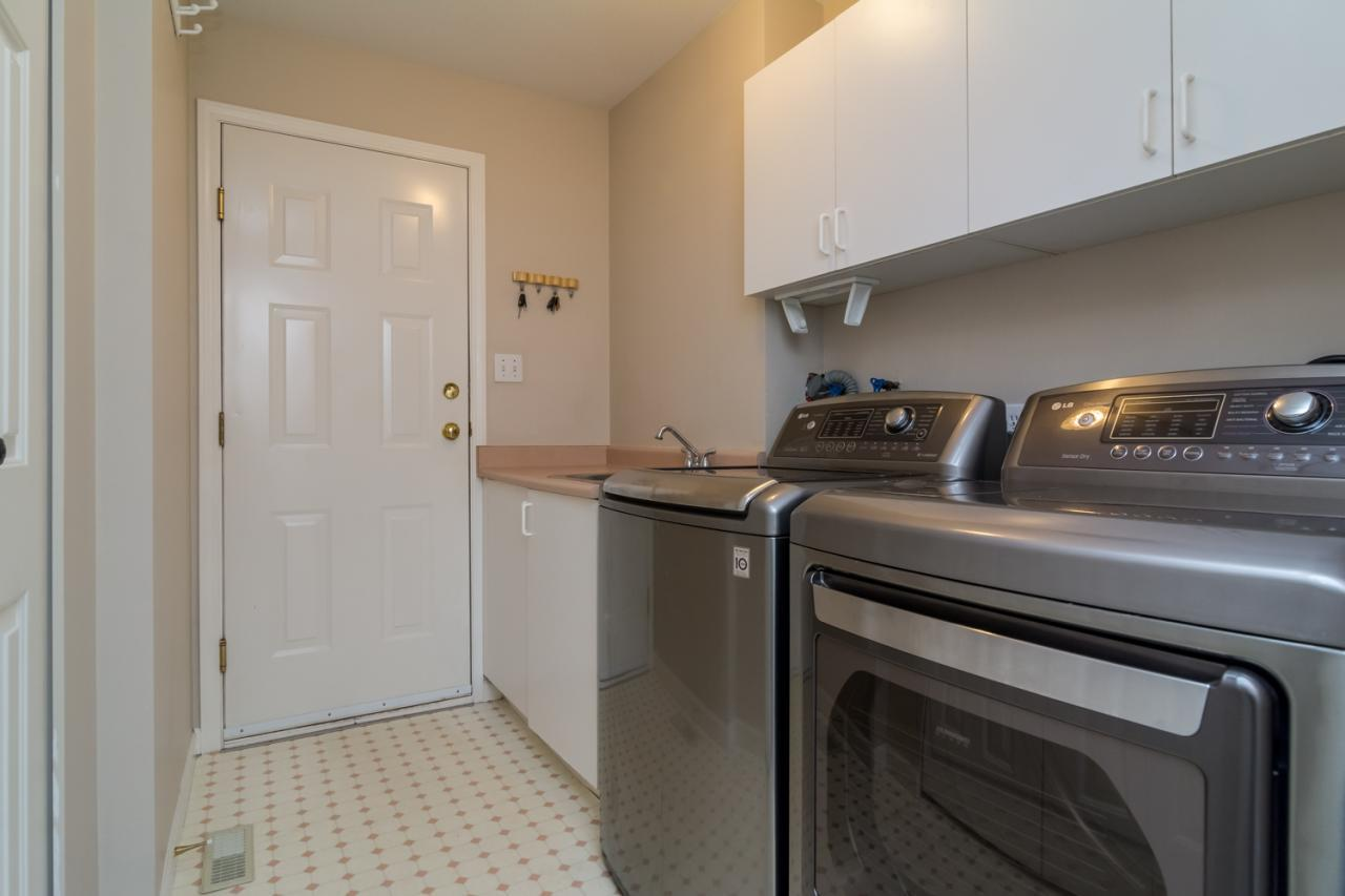 Laundry room  at 9744 205a Street, Langley City, Langley