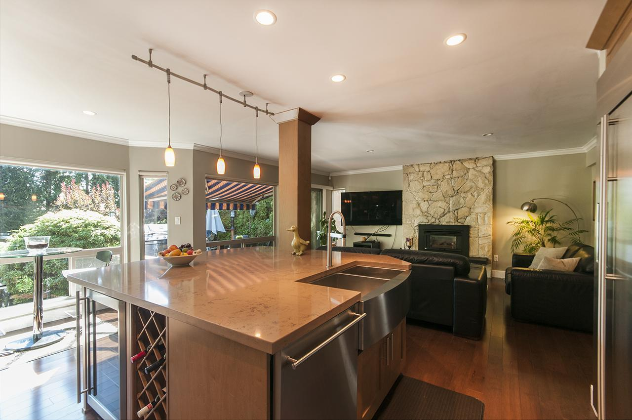 Kitchen to Family Room/Decks at 555 Palisade Drive, Canyon Heights NV, North Vancouver
