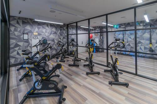 55-merchants-wharf-suite-213-large-055-040-cycling-room-1499x1000-72dpi at 15 Merchants' Wharf, Waterfront Communities C8, Toronto