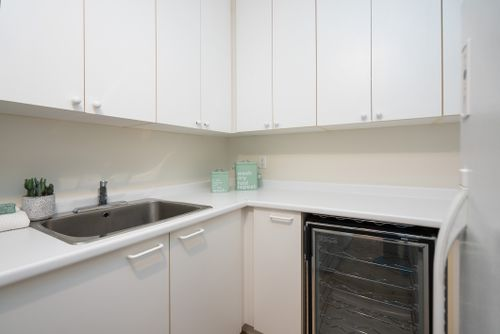 1-balmoral-avenue-suite-805-print-056-039-laundry-room-4200x2806-300dpi at #805 - 1 Balmoral Avenue, Yonge-St. Clair, Toronto
