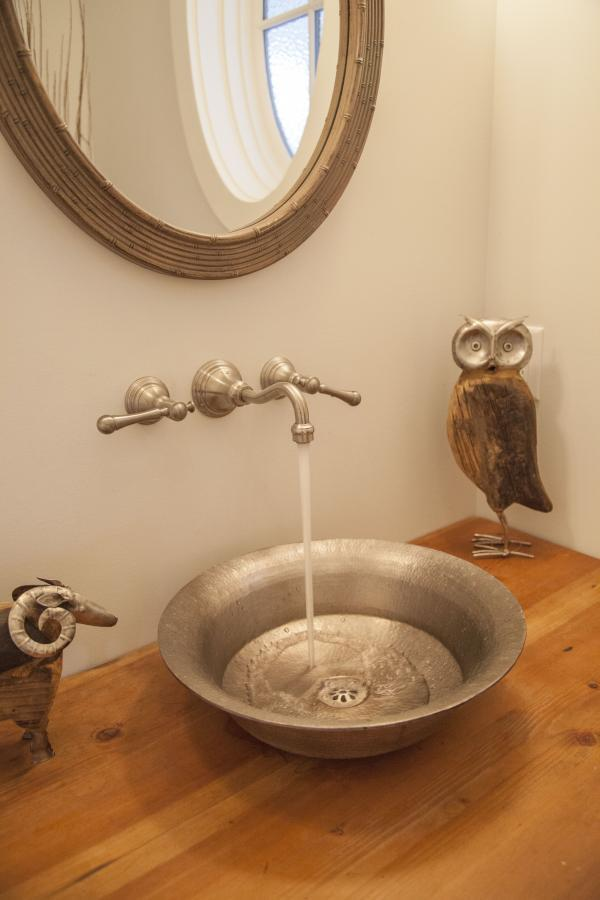 Unique sink in powder room at 2478 Kings, Dundarave, West Vancouver
